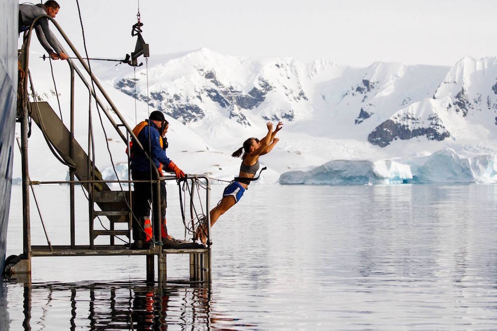 Identical twins Theresa and Rachie first in for the Polar Plunge. image: Court Leve/Ice Axe Expeditions