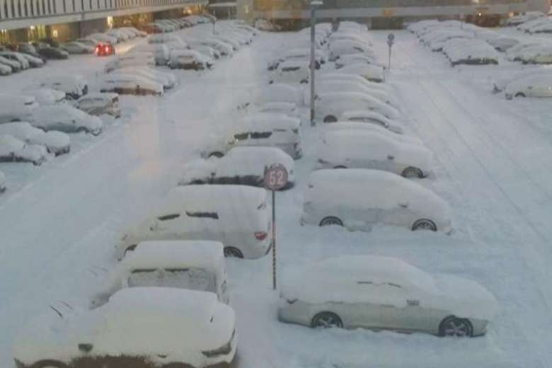 Cars outside Sapporo's New Chitose Airport lie covered in snow, on Dec 12, 2016. PHOTO: JASON GOH