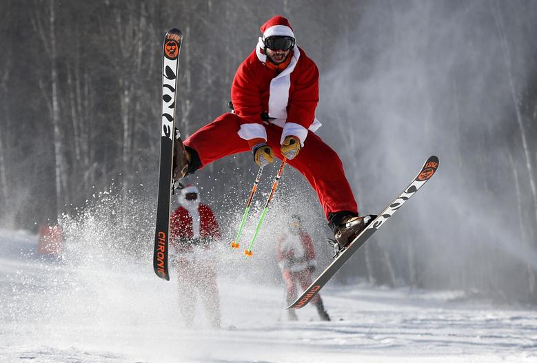 Santa busts a move on the slopes of Sunday River, December 4, 2016 Credit: AP Photo/Robert F. Bukaty