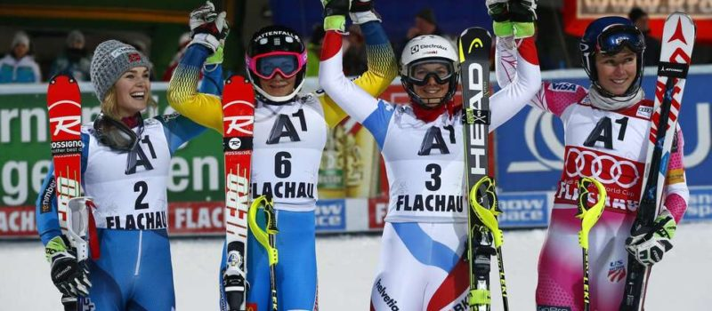 From left; Norway's Nina Loeseth, Sweden's Frida Hansdotter, Switzerland's Wendy Holdener and United States's Mikaela Shiffrin celebrate at the end of an alpine ski, women's World Cup slalom in Flachau, Austria, Tuesday, Jan. 10, 2017. (AP Photo/Giovanni Auletta)