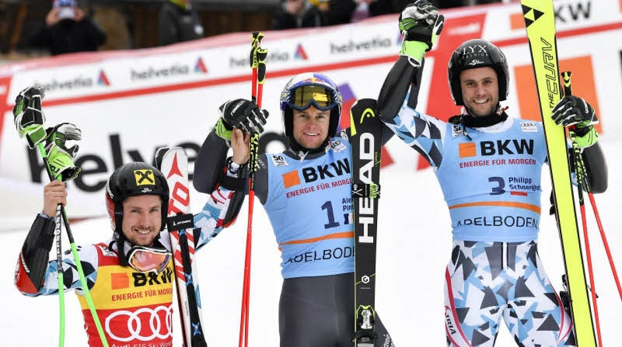 From left, Austria's Marcel Hirscher, second placed, France's Alexis Pinturault, the winner, and third placed Philipp Schoerghofer, of Austria, celebrate at finish line after an alpine ski, men's World Cup giant slalom in Adelboden, Switzerland, Saturday, Jan. 7, 2017. (AP Photo/Alessandro Trovati)