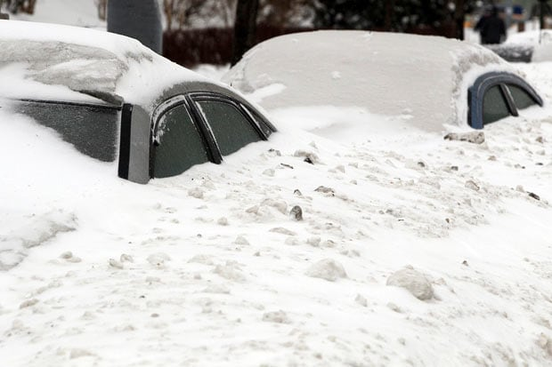 stock image of snow on cars.
