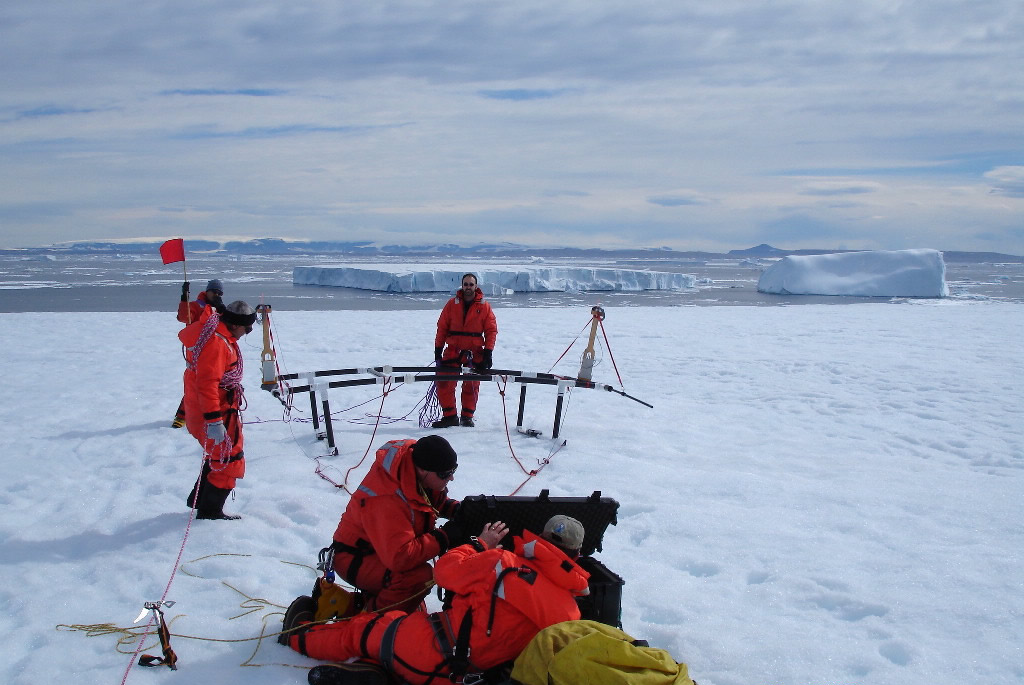 Scientists test their equipment on a small iceberg during the 2006 IceTrek expedition. Credit: Ted Scambos, NSIDC