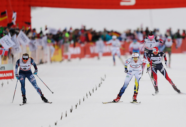 Jessie Diggins (left) and Stina Nilsson sprint to the finish of the skiathlon race on Tuesday in Oberstdorf, Germany. (Getty Images- Nils Petter Nilsson)
