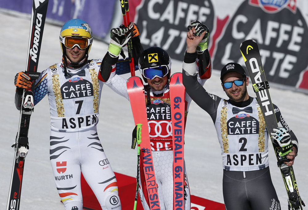 France's Mathieu Faivre, left, Austria's Marcel Hirscher, center, and Germany's Felix Neureuther celebrate after the second run of a men's World Cup giant slalom ski race Saturday, March 18, 2017, in Aspen, Colo. (AP Photo/Nathan Bilow)