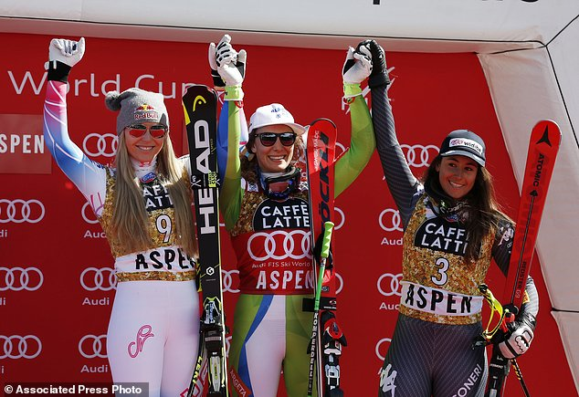 From left, second place finisher United States' Lindsey Vonn, first place finisher Slovenia's Ilka Stuhec and third place finisher Italy's Sofia Goggia celebrate at the women's World Cup downhill ski race Wednesday, March 15, 2017, in Aspen, Colo. (AP Photo/Brennan Linsley)