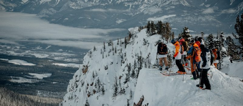 Skiers line up before dropping into the Freeride World Qualifiers