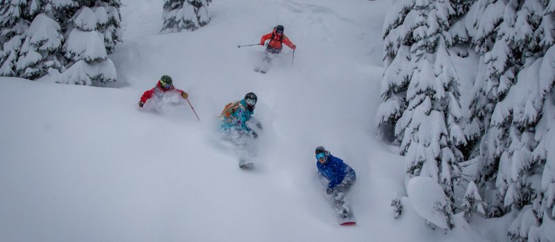 Snowboarders and Skiers finding face shots on the same run