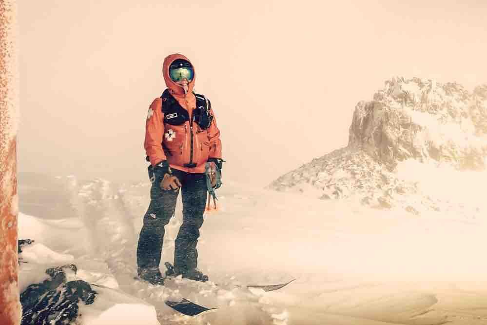 Amy in ski patrol uniform up on emigrant ridge