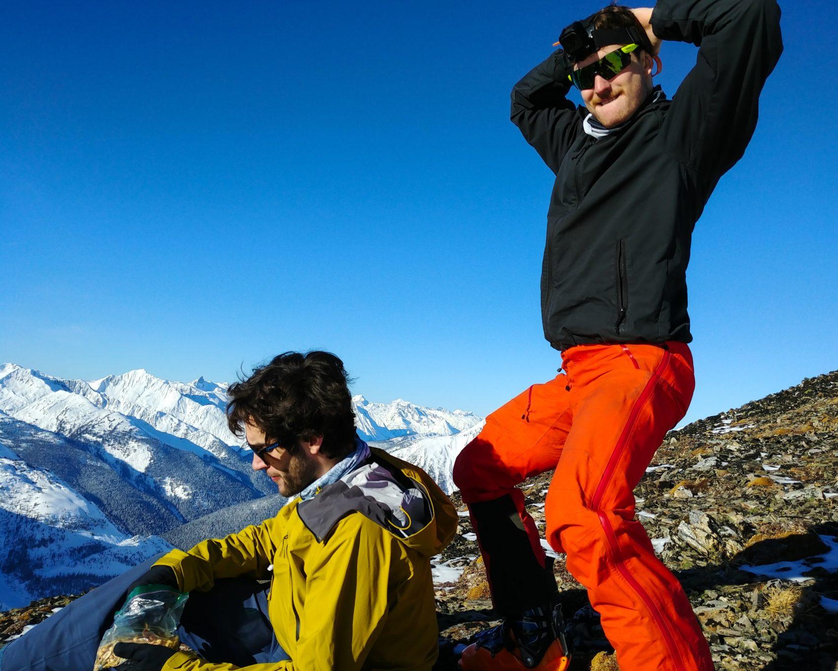 skier teasing snowboarder