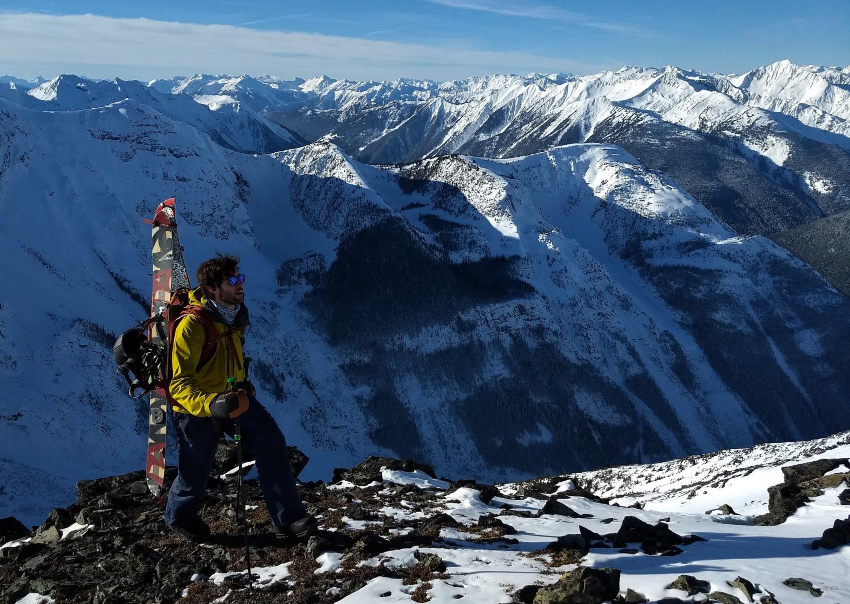 splitboarder hiking up ridge