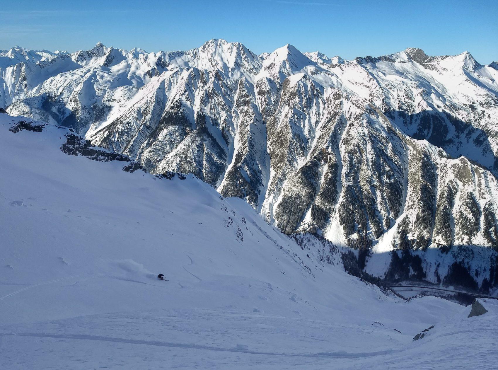 skier down ross peak path