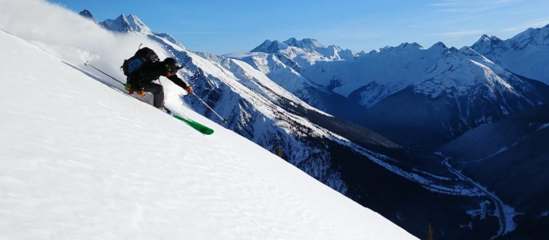 skier slashing turn at rogers pass