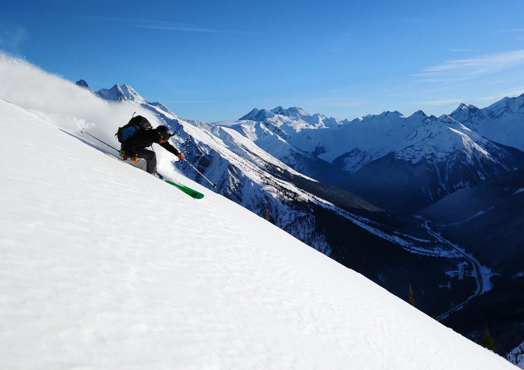 skier slashing turn at rogers pass