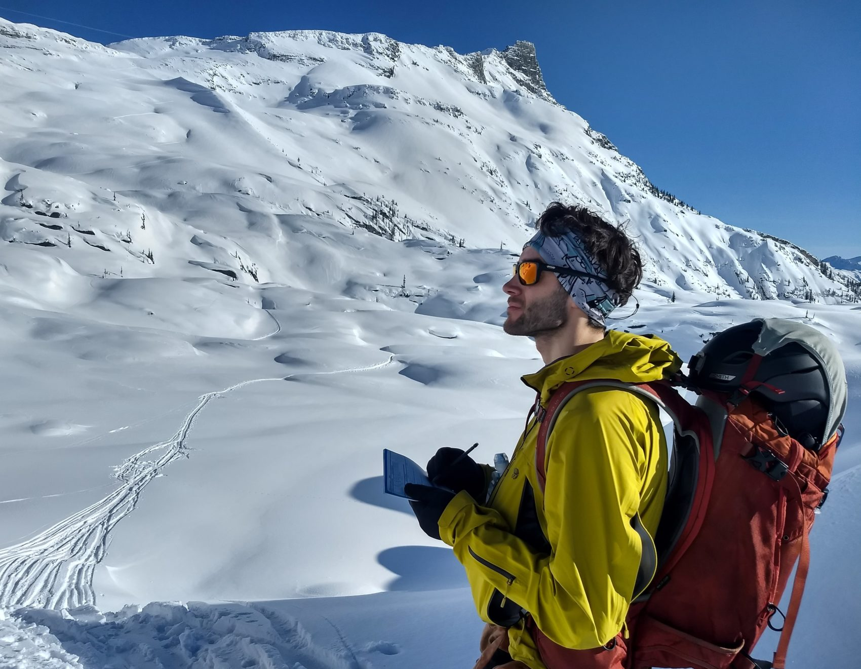 backcountry skier checking out avalanche danger