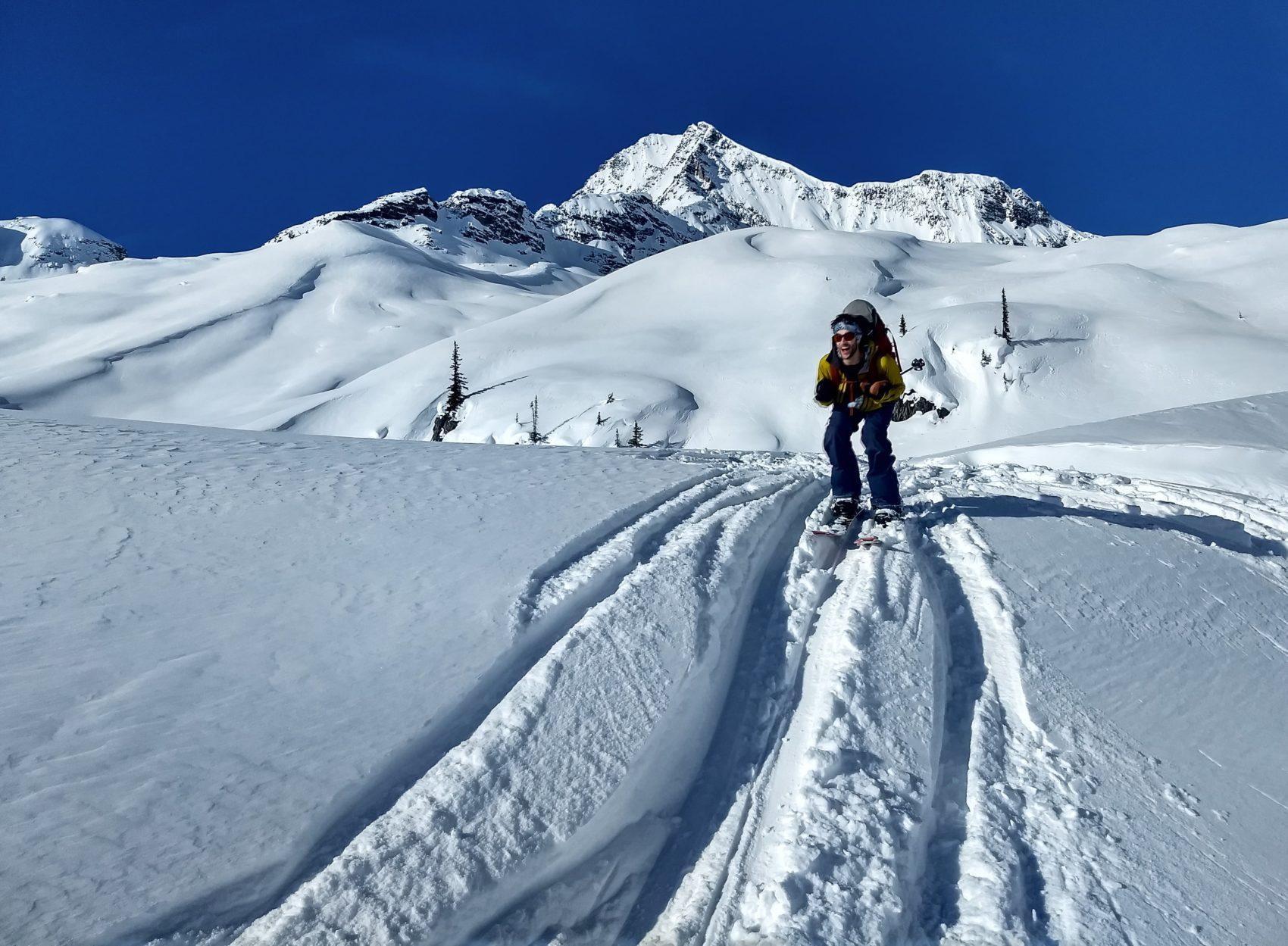 splitboarder giving skiing a go