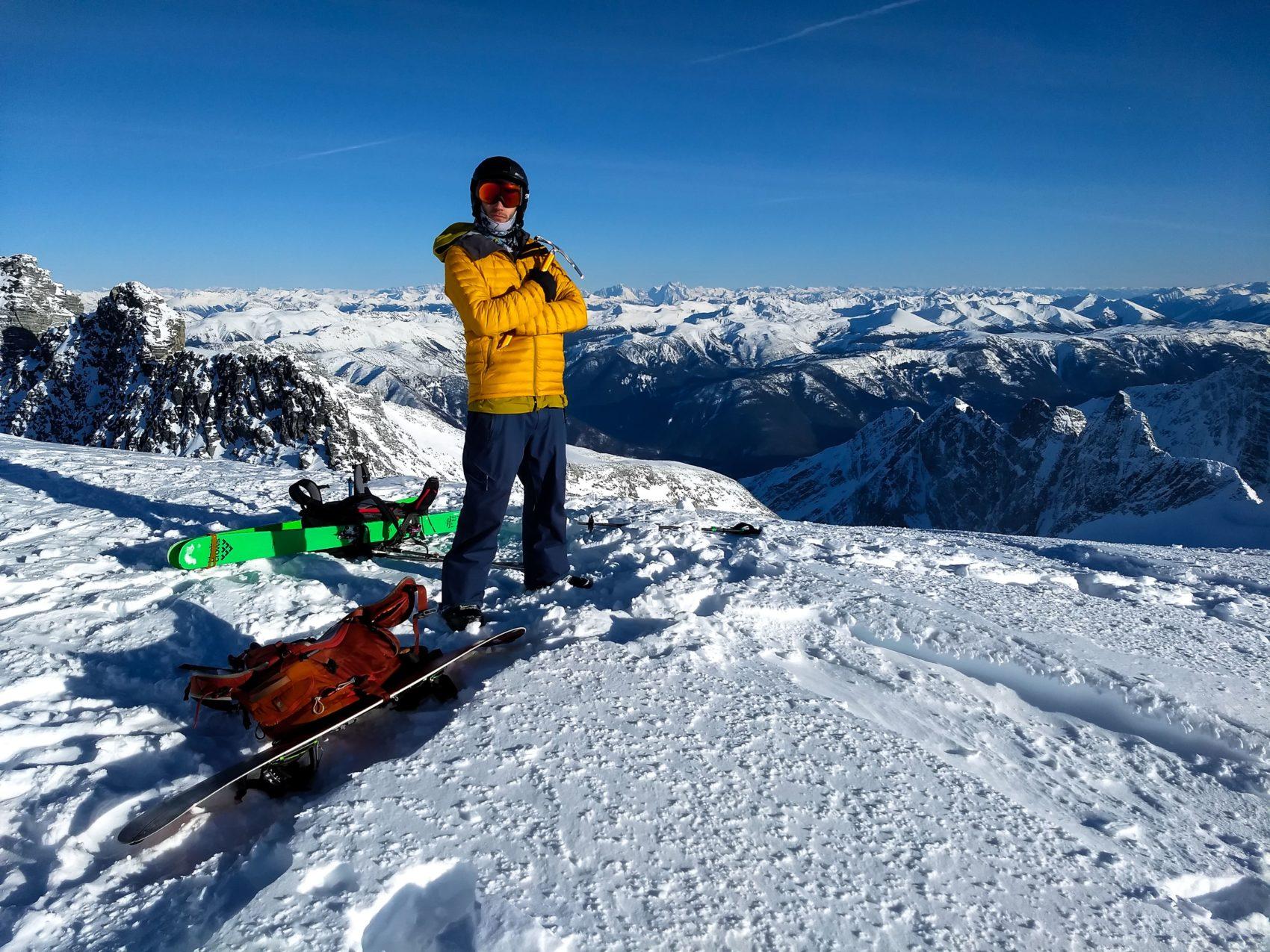 splitboarder at the summit of rogers peak