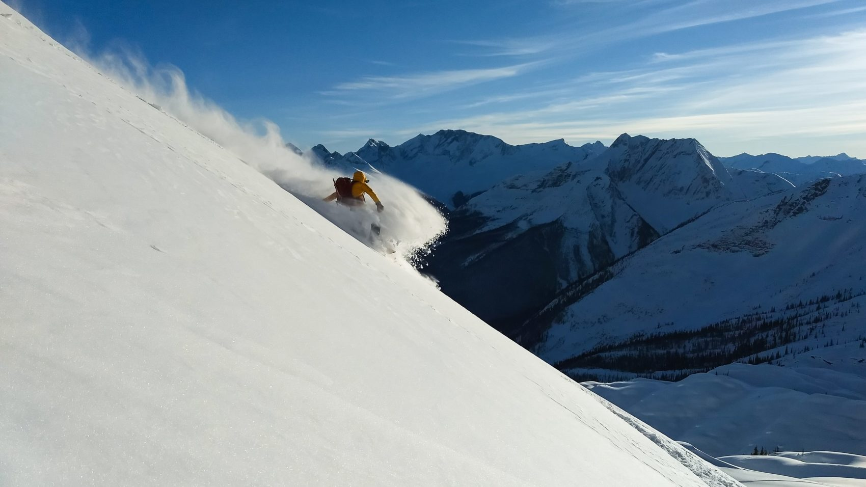snowboarder carving down the hermit valley