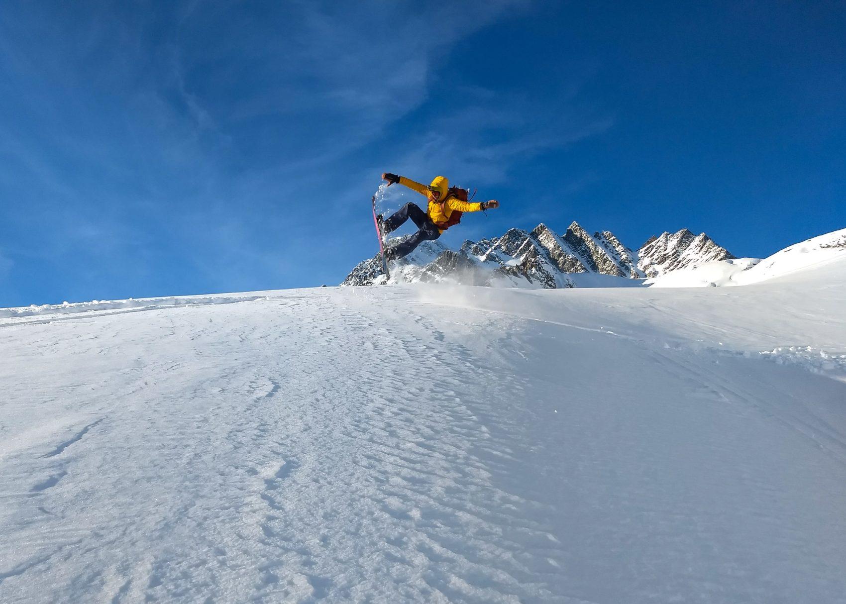 snowboarder tricks on rogers glacier