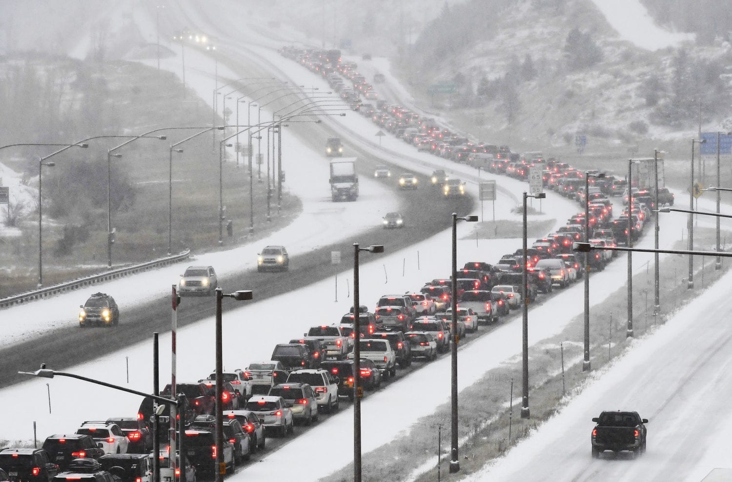Traffic on Interstate 70 from Denver. Delays from weather and big surge of travelers