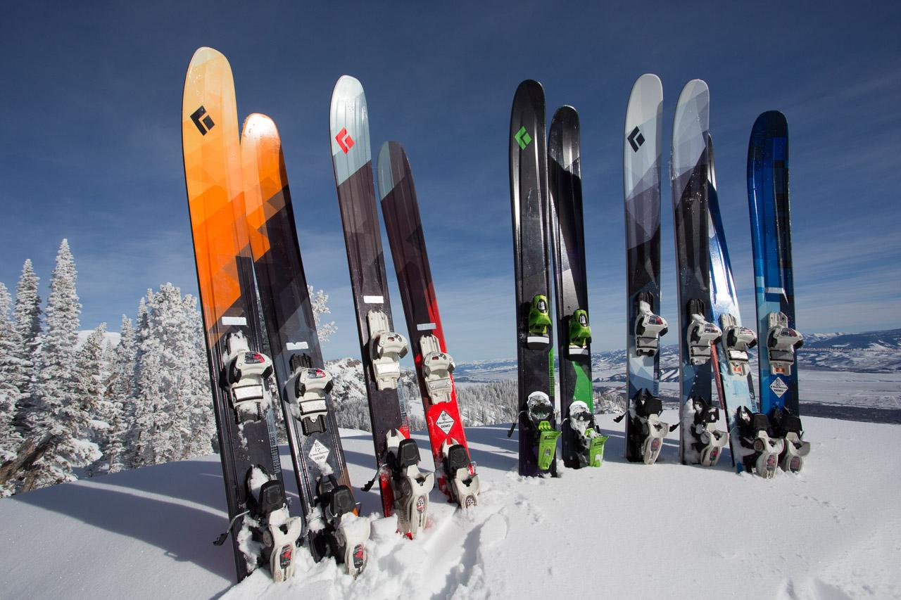 Black Diamond skis all lined up.