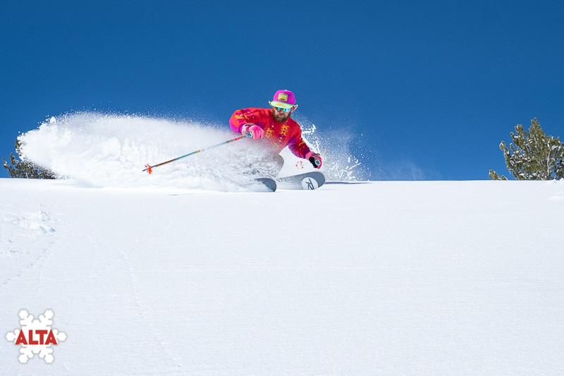 An Alta skier slashing pow, alta or snowbird?