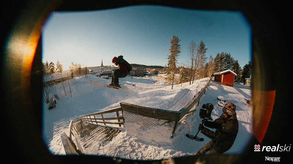 skier jumping into a rail filming for x games real videos