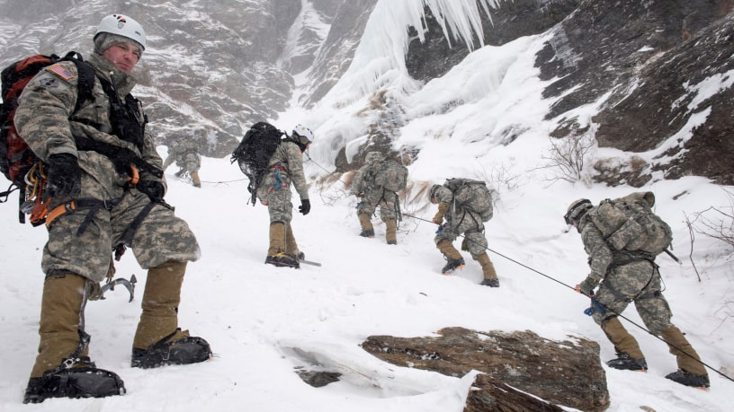 CPT Jason Beams, Army Mountain Warfare School in Jericho, VT, observes Soldiers climbing Smugglers' Notch during their final phase of the Basic Military Mountaineering course. (Photo by TSgt Sarah Mattison)