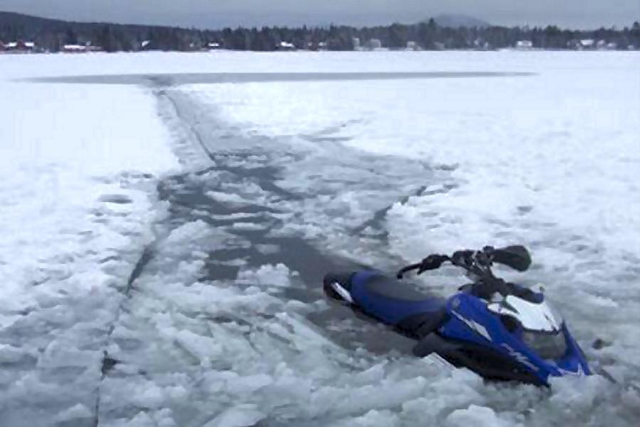 fire, survive, rescue, snowmobilers, frozen lake, montana