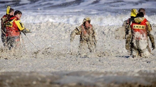 netherlands, storm, foamy seas, surfers killed,