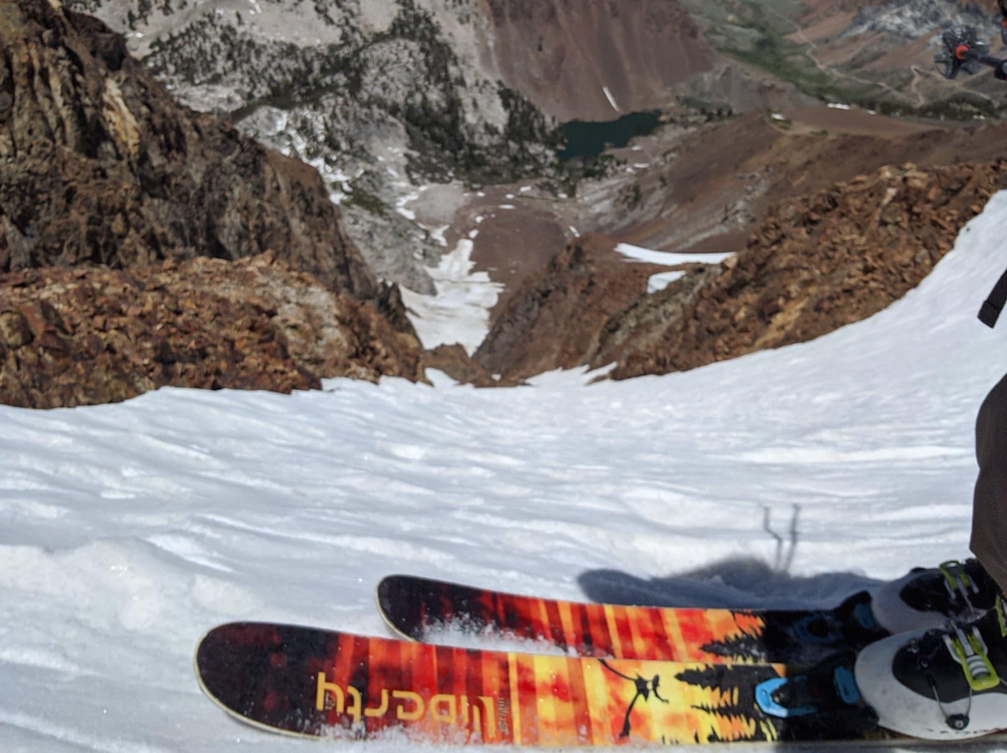 going down into a giant ski run