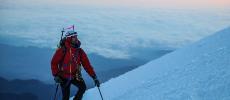 A mountaineer ascends a slope.