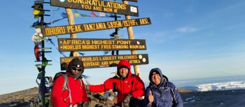 Climbers on the Summit of Kilimanjaro, a prominent mountain peak that is a popular location for cases of HAPE and HACE.