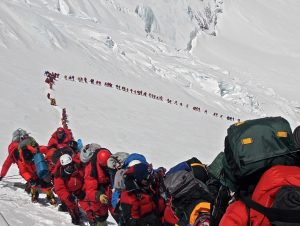 Line of climbers on their ascent of Everest