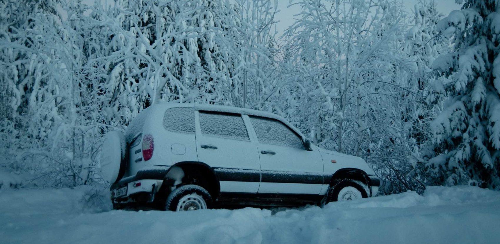 stranded, car stuck in snow,