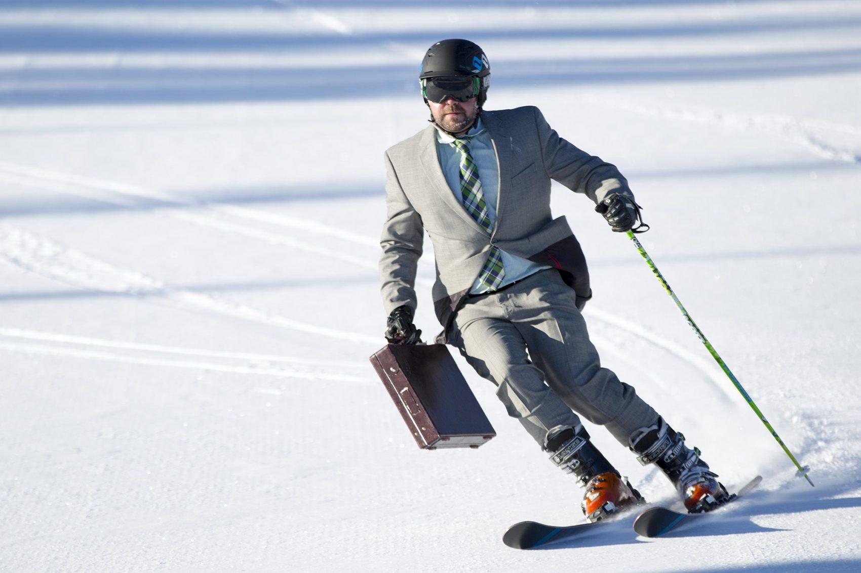 Business man skiing