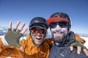 Two men on mountain summit