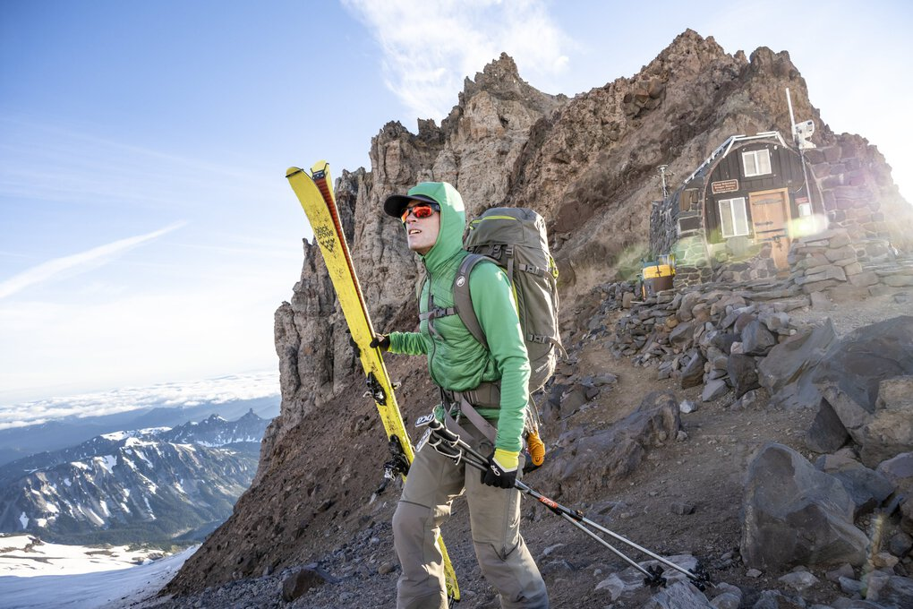 Climber on mountain with skis
