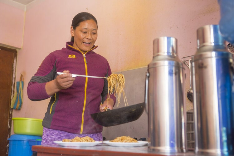 Woman cooks a meal