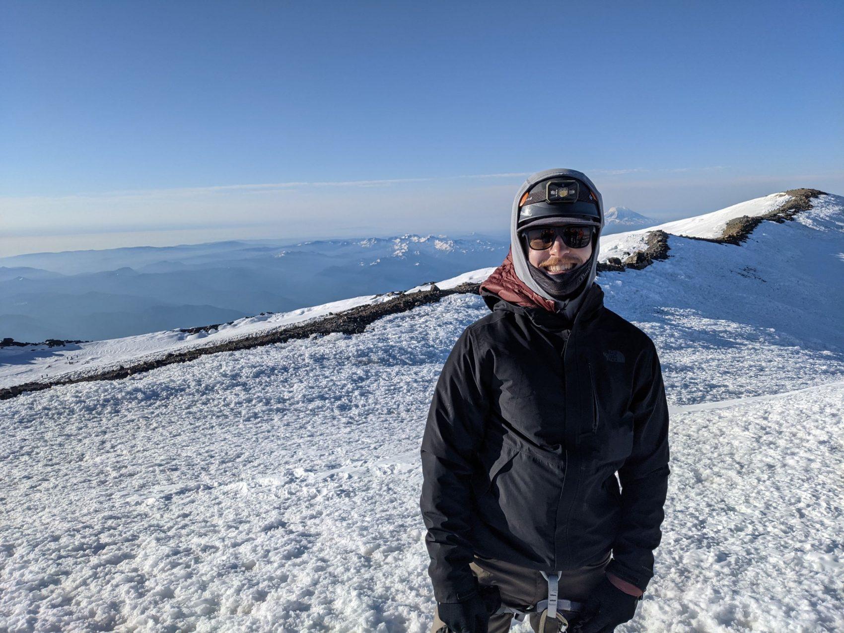 Boy on mountain top, rainier, Washington