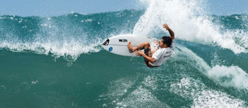 surfing wave olympic rider